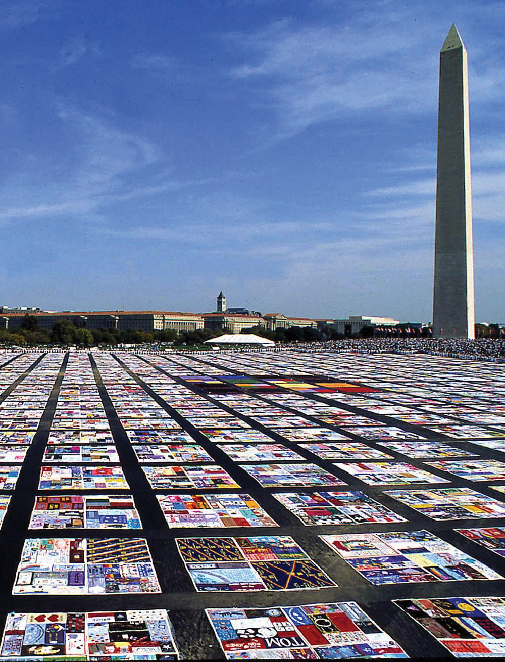 AIDS memorial quilts laid out in front of the Washington Monument