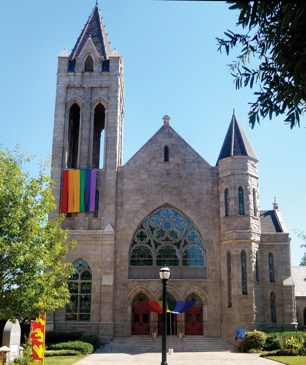 Saint Mark Church with a pride flag hanging from it